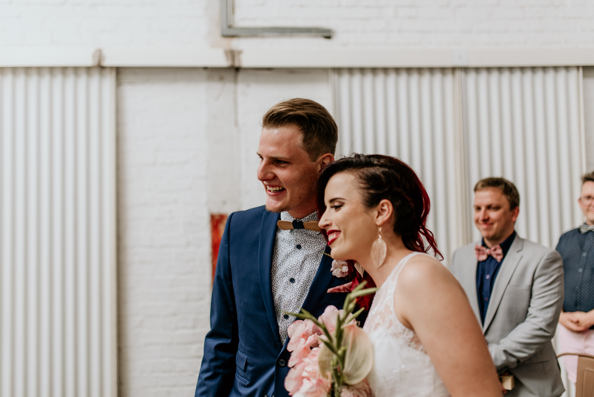 Groom in blue suit and bride at alter in maboneng johannesburg city - by Dillon Kin Photography