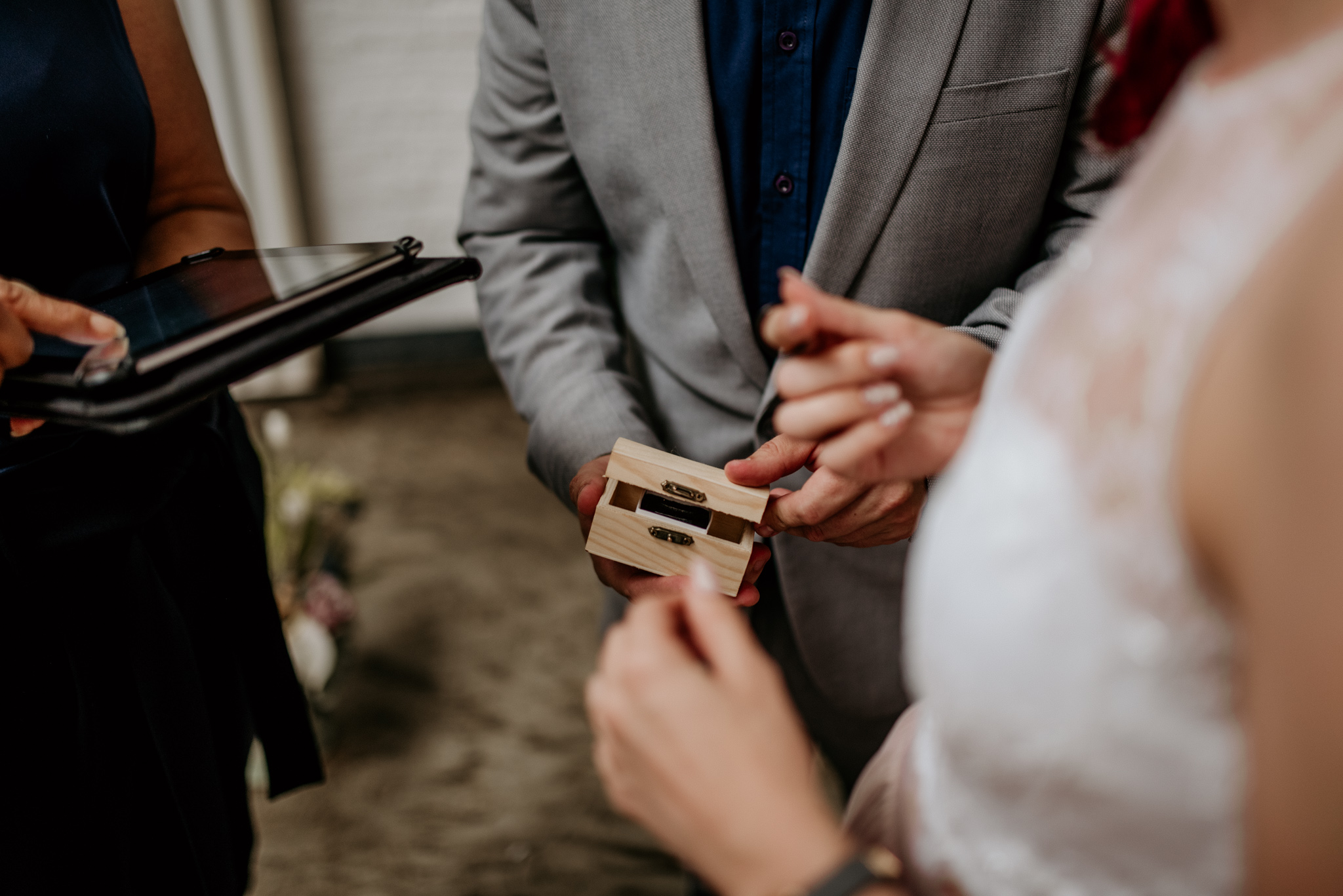 A close friend hands a small wood box to bride during johannesburg city wedding