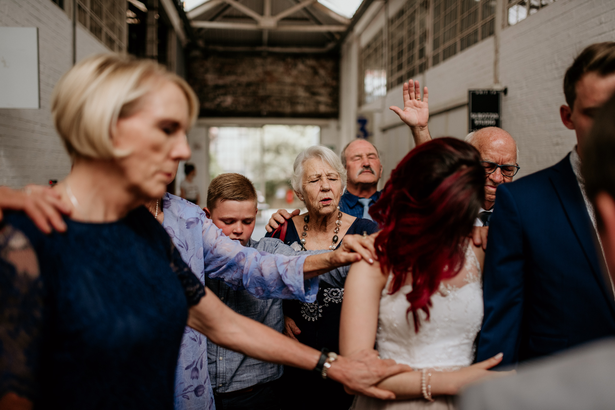 Close family and friends pray over a newly wed couple in downtown Johannesburg