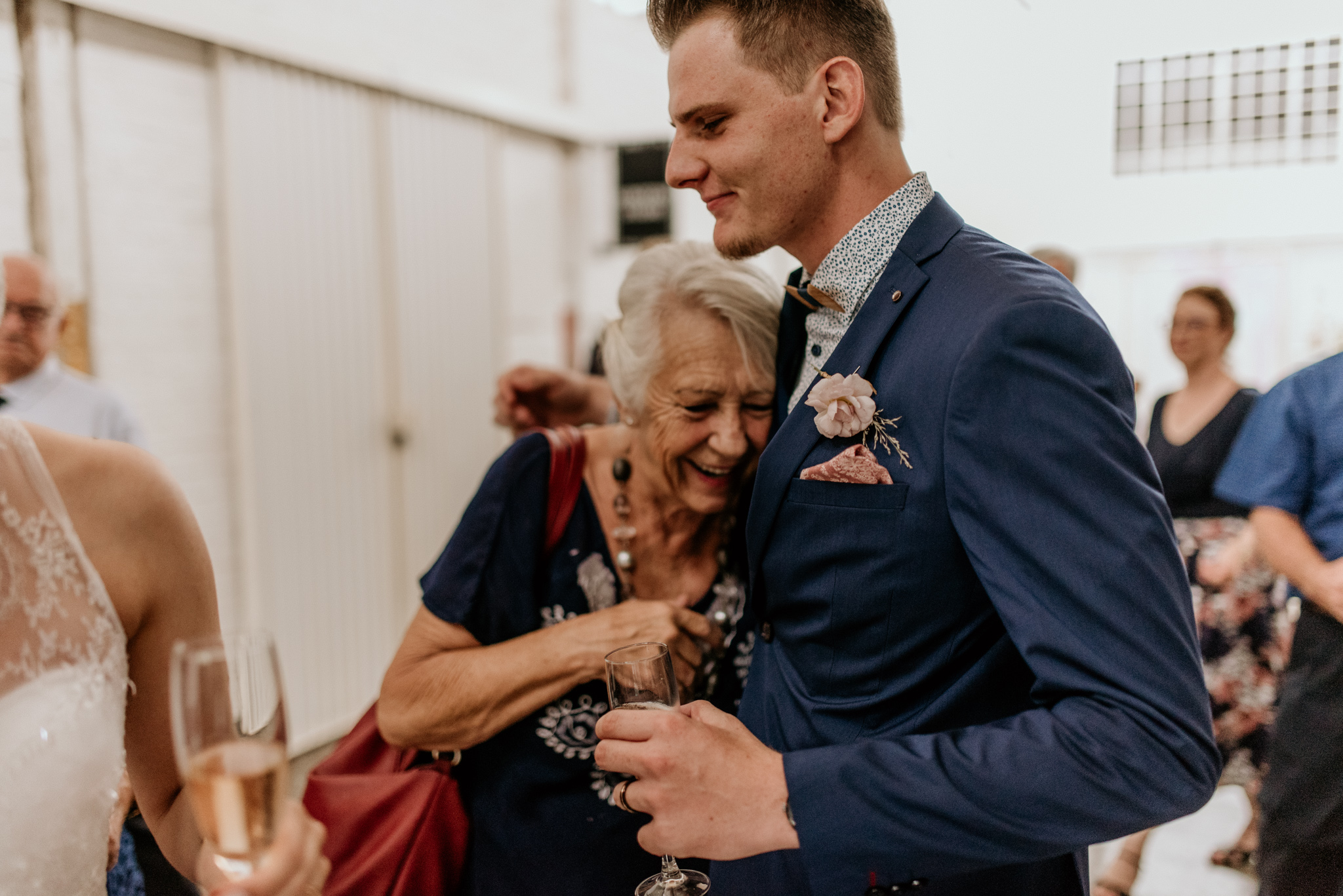 Grandmother is filled with joy as she hugs her grandson after he got married in johannesburg