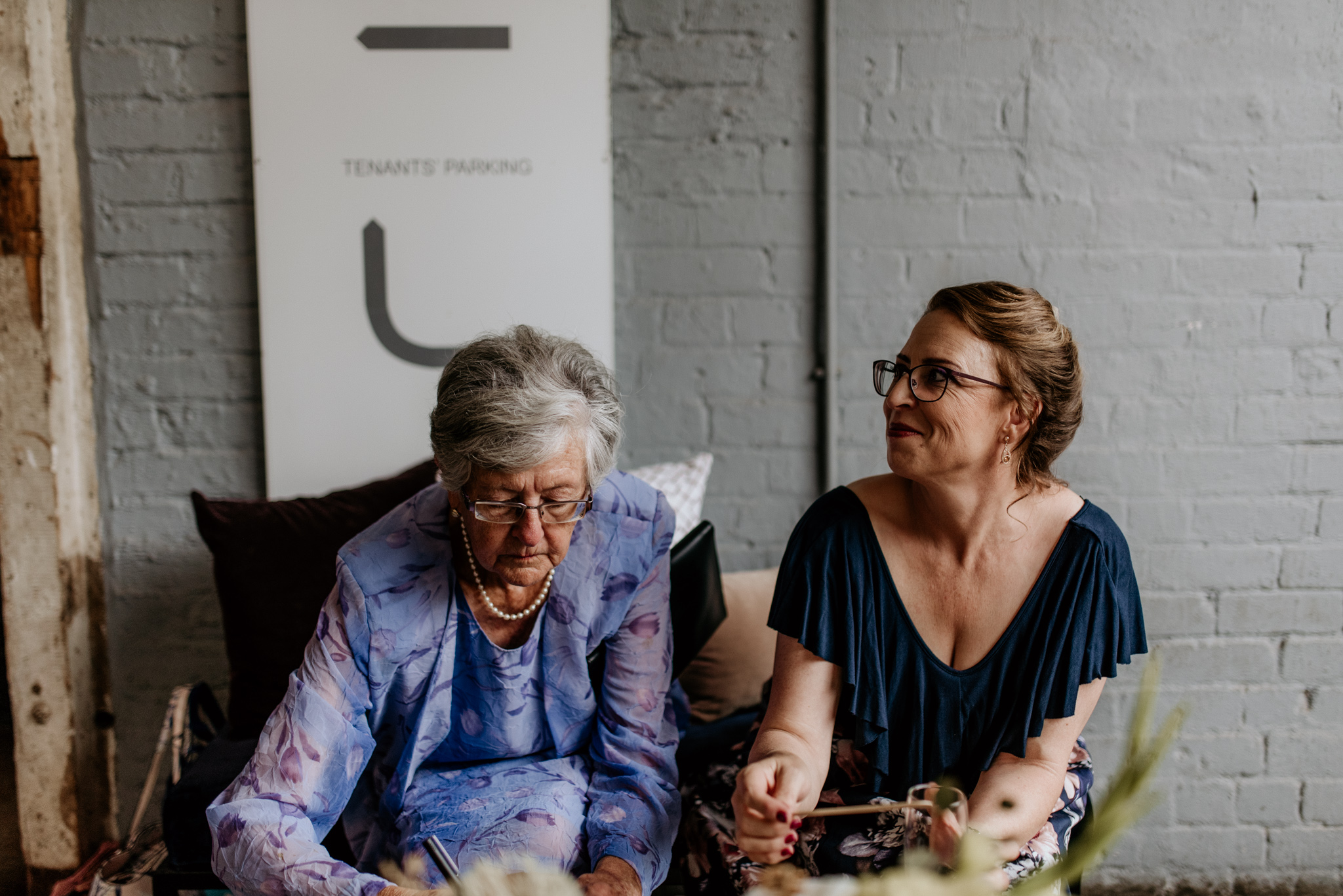 A mother and grandmother share wedding cake at a joburg wedding in Maboneng