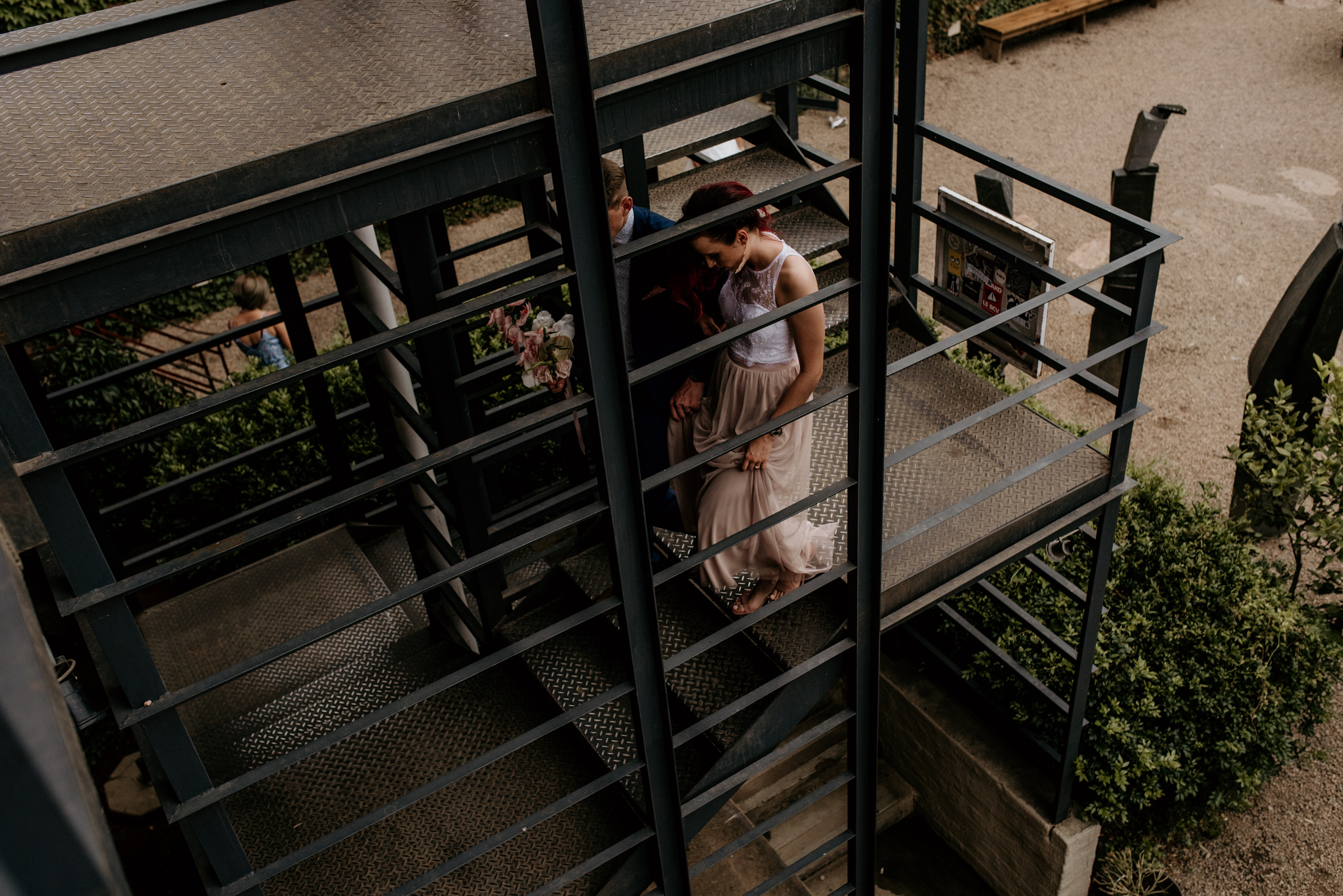 Bride and groom exploring Arts on Main Maboneng after their wedding