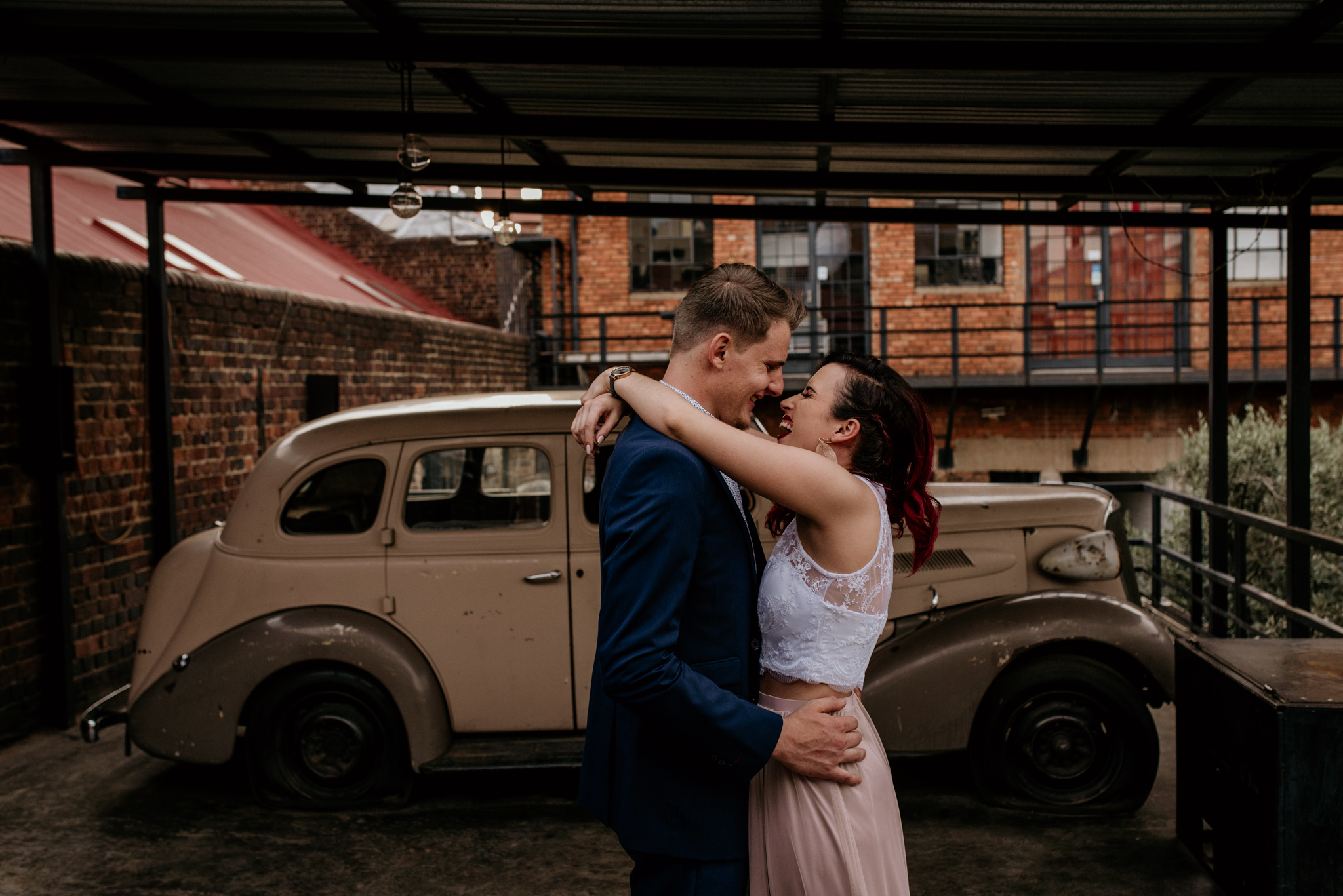 Trendy young bride and groom share a dance in Maboneng Johannesburg