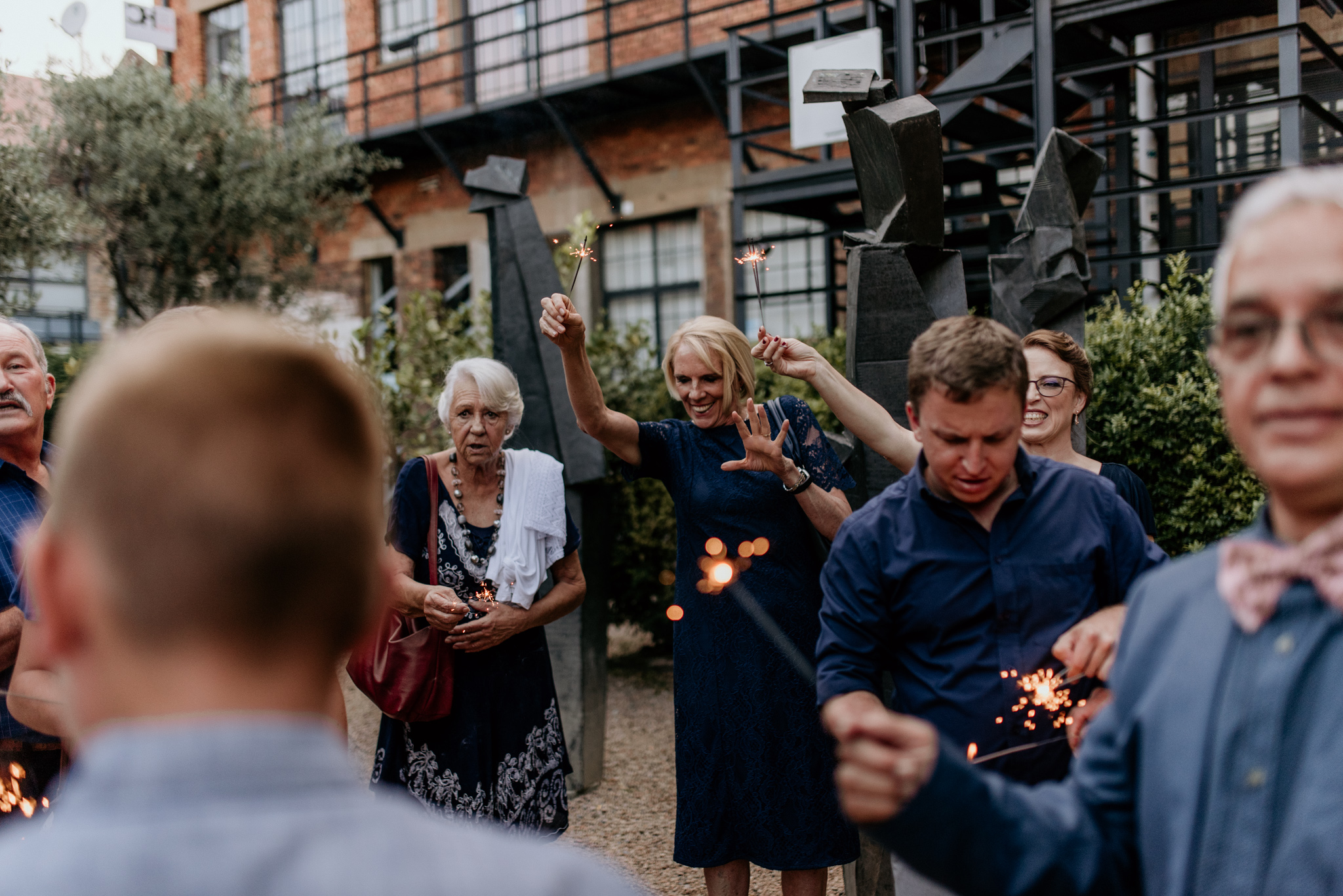 Wedding guests light up sparklers at Arts on Main Maboneng wedding